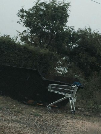 Riverside Hotel & Restaurant: a supermarket trolley abandoned in the car park