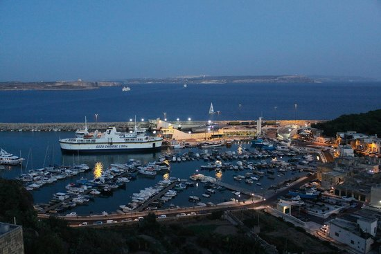 Grand Hotel Gozo: Harbour at nightfall from our room