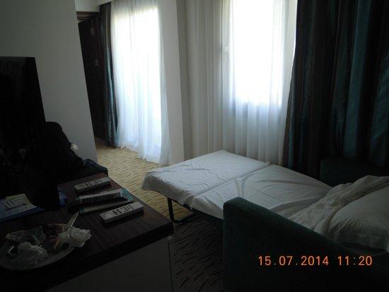 Palm Wings Beach Resort: familale double chambreetriqué,étroit ,lit de camp