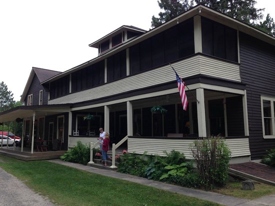 North Branch Outing Club: Innkeeper Judy Fuller on front porch of historic NBOC