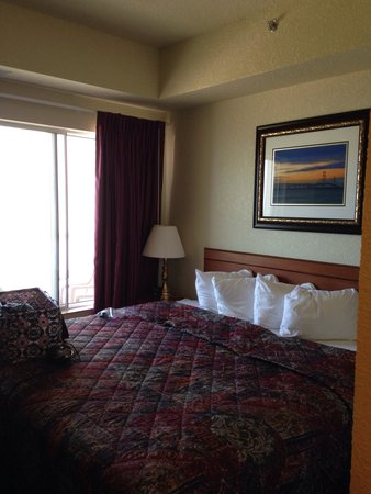 Mackinaw Beach and Bay - Inn & Suites: King bed in extra large suite. Balcony outside