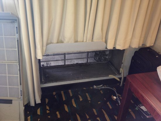 Wyndham Chicago O'Hare : The dust behind the ac unit that we were exposed to after they removed the old ac unit from our