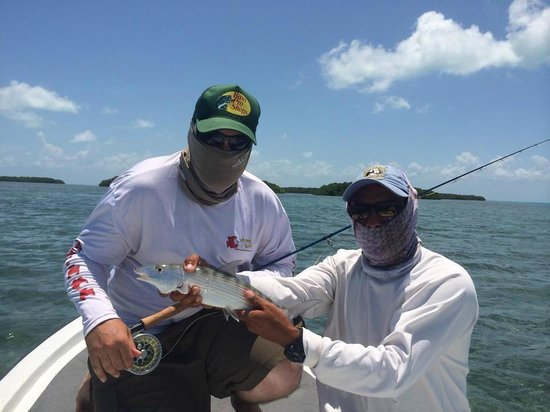 Chasin Tail: My son and Ken with his first bonefish.