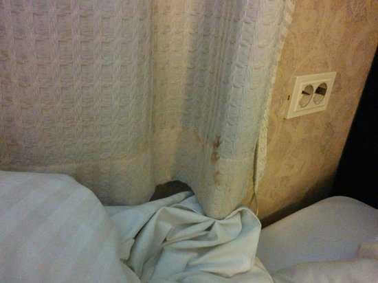 Western CO-OP Hotel & Residence: Curtain stains...right next to the bed...