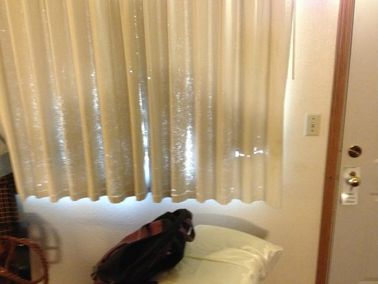 Flagstone Motel: Outer curtains so frayed the sunlight comes through