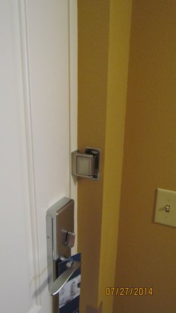 Brunswick, GA: Door safety lock prevents entry into the room