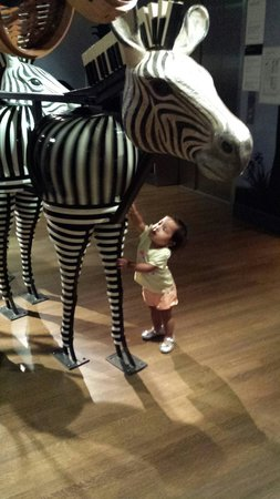 Skirball Cultural Center : One year old Calissa greeting the zebra.