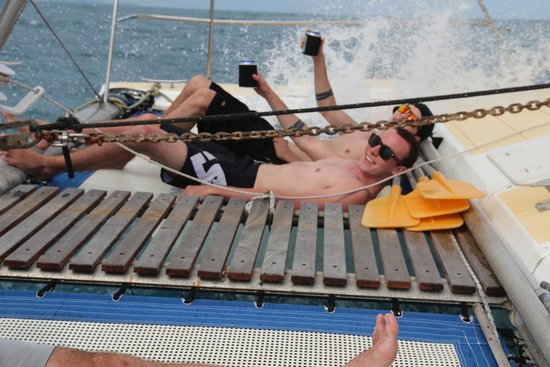 SY Nakamal Sail and Dive Charters: The boys enjoying the waves and a beverage