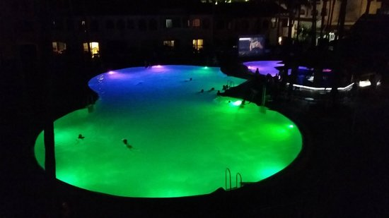 Los Amigos Beach Club: The pool at night. There was a dive inn movie hence the swimmers