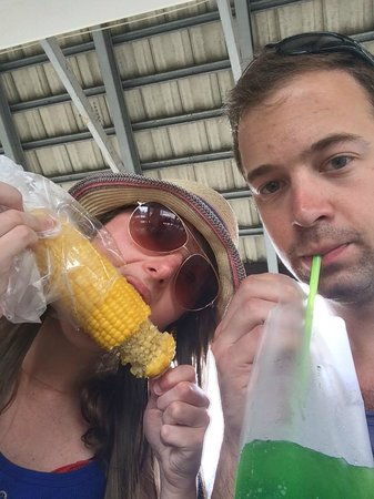 Anantara Riverside Bangkok Resort: Sweet corn from the street vendor and juice in a bag!