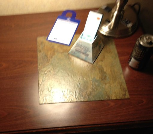 Best Western Airport Albuquerque InnSuites Hotel & Suites: Tiles glued to dresser, one even had glue oozing out of it