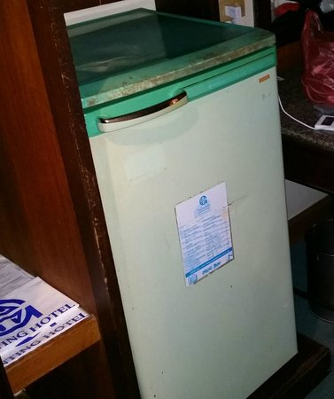 Narathiwat, Thailand: The old rusty refrigerator in the room.