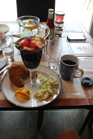 Solstice Bed and Breakfast: Breakfast, fresh crouisants, eggs, fruit salad, and coffee.