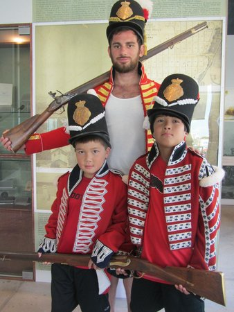 Niagara Falls History Museum: Grandsons & an uncle try on woolly 1812 uniforms