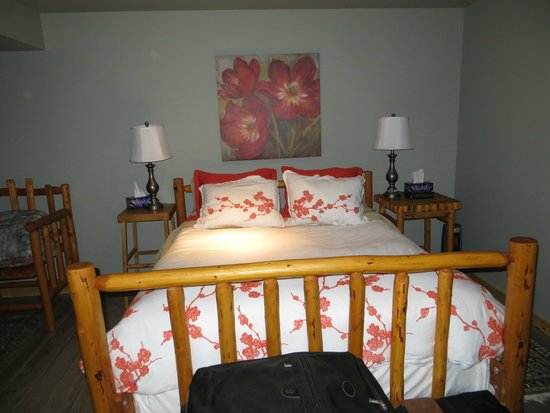 Kicking Horse Canyon B&B : Basement Suite-  The bedstead, hand-crafted log furniture, was made by Jerry!