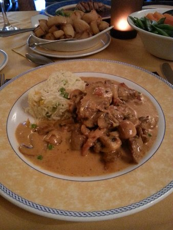 The Village Bistro: Beef Stroganoff  (mini roast potatoes with bacon in background)
