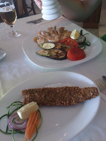 Djanny: White fish in crust and chicken fillet with vegetables and potatoes