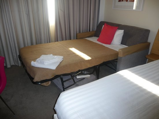 Novotel London Paddington: Bed with unwanted sofa bed