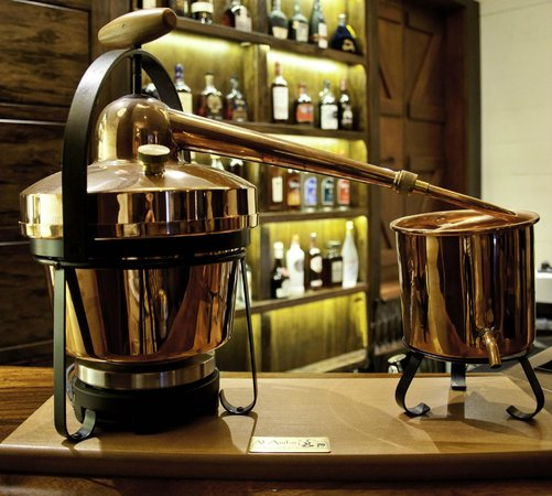 Takamaka Rum Distillery: Traditional Copper Pot Still model in our Bar
