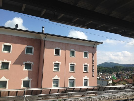 Hotel Uzwil: Back view from the station. Much more picturesque from the front