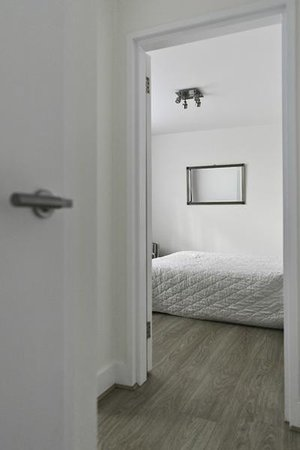 202 Modern Service Apartments: Hall towards bedroom