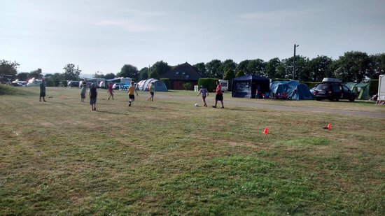 Rousdon, UK : Everyone joining in with Footie at Shrubbery.