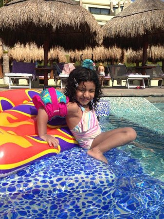 Paradisus Cancun: My daughter inside the pool