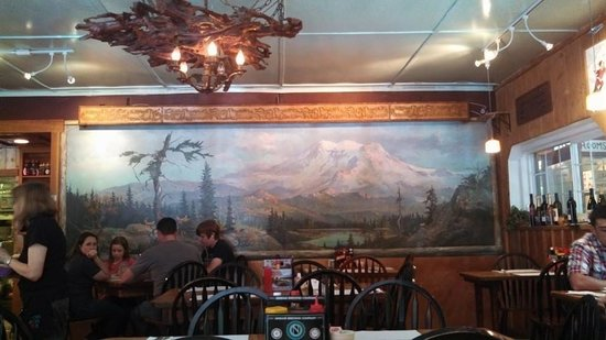 Copper Creek Inn Restaurant: Inside the dining room...there's a great mural and neat antler lighting!