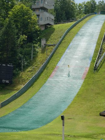 Olympic Ski Jump Complex : Looking so small on the landing hill just before touch down