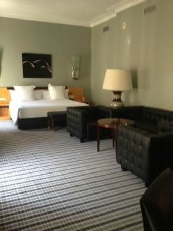 Room Mate Larios : View of bed and seating area
