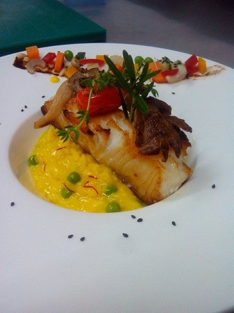 Sassorosso : Pan fried cod fish Iranian saffron risotto and green peas ™