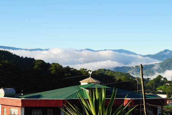 St Joseph Resthouse : you can see the Cordillera mountain range from my room and Cafe St. Joe at the building in front