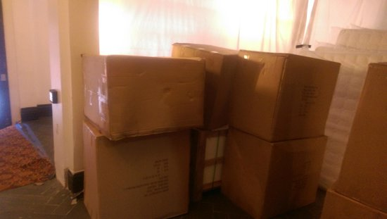 Adante Hotel: Boxes stacked in entry way