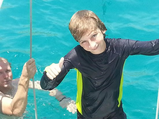 Cabo Mar Fiesta Dinner Cruise : Collin having a blast jumpring off the boat...