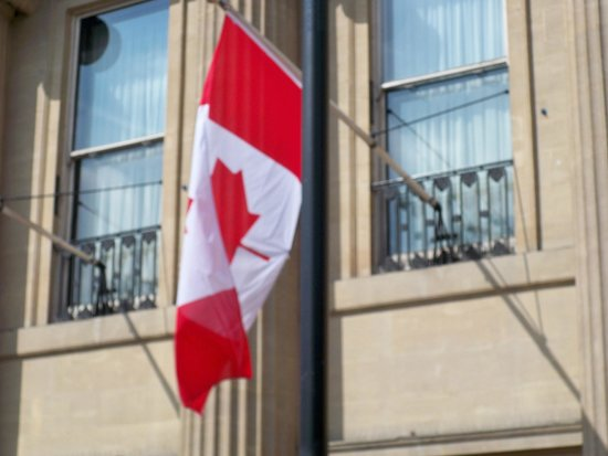 Golden Tours: A little pice of home Canadian flag hanging off of Canada House in Trafalgar Square.