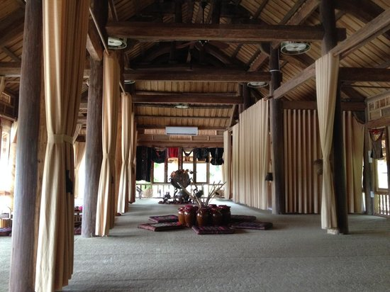 Moon Garden Homestay: Stilt House - Communal, Living space divided by curtains.