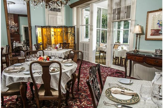 The dining room and glass enclosed dining porach Picture of