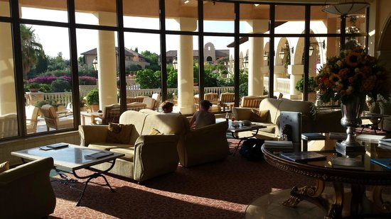 Elysium Hotel: lobby + bar looking out on terraces (pools and garden are one level down)