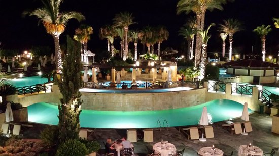 Elysium Hotel: pool area by night, looking towards the sea