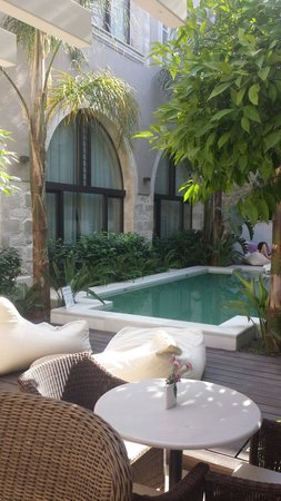 Rimondi Boutique Hotel : Beautiful pool area, unfortunately a little green due to weather but a lovely place to relax
