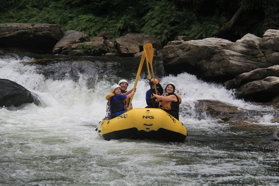Southeastern Expeditions: Paddle High-Five on the Chattooga River