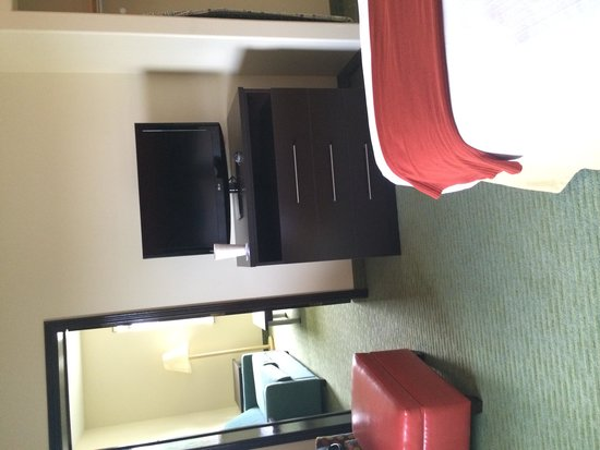 Holiday Inn Express Hotel & Suites Brownsville: View looking into 2nd room with jacuzzi, sofa bed, and TV.