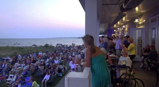 Madison Beach Hotel: View from dining deck overlooks audience gathering for the Thursday evening seaside concert