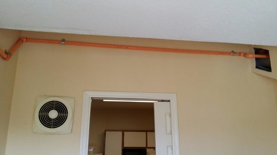 Extended Stay America - Fishkill - Route 9: Bedroom ceiling with Stains, Holes & Orange Pipe