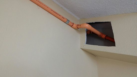 Extended Stay America - Fishkill - Route 9: Wall Hole with Pretty Orange Pipe across Bedroom Ceiling