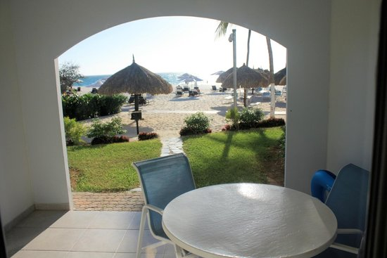 Costa Linda Beach Resort: looking out living room onto patio and beyond