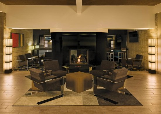 Best Western Plus University Inn : Visit your friends and colleagues around the fireplace in our main lobby