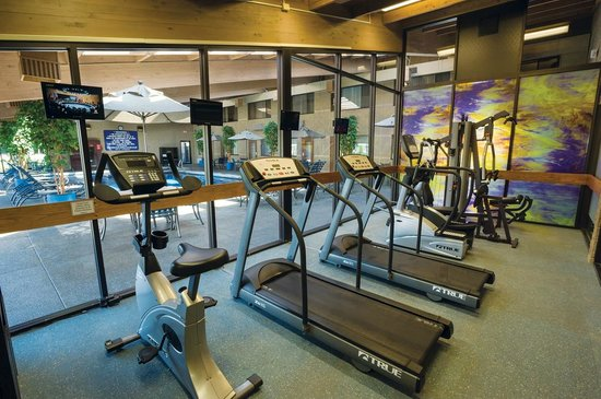 Best Western Plus University Inn : Fitness center overlooks our indoor pool