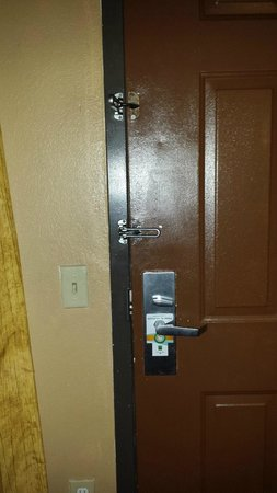 Quality Inn & Suites Fort Jackson Maingate: Front door with two double locks. The one that did not work was still on the door with no purpos