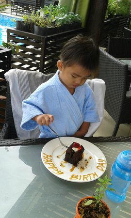 The Cocoon Boutique Hotel: our little Pogi enjoying hubby's brownie treat